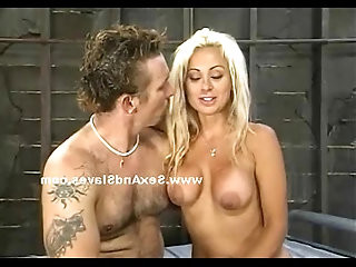 Blonde playing with big tits laying on her back