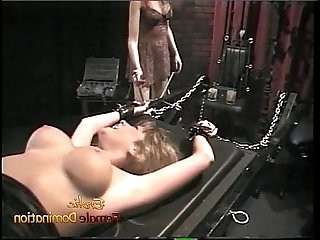 Luscious blonde likes having her pussy pleasured in the dungeon