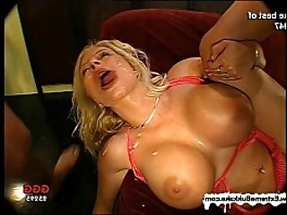 Busty Melanie and her friend clean each others jizzed faces with their tongues